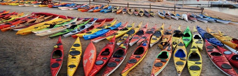 Contact the Great Lakes Sea Kayak Symposium -kayaks on the beach
